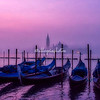 View across the lagoon from St Marks towards Isola San Giorgio Maggiore in the early morning light and fog, Venice