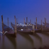 Ghostly gondolas at their mooring in the fog, Venice