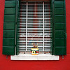 Green shutters on a red building, Burano, Venice