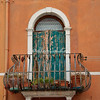 Faded green shutters and wrought iron balcony, Burano, Venice