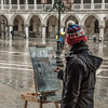 Daisy, Sims-Hilditch, an award winning fine artist, painting in Piazza San Marco, Venice, on a cold, wet, winter morning.