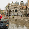 Daisy Sims-Hilditch, an award winning fine artist, painting in Piazza San Marco, Venice,  on a cold, wet, winter morning