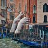 """SUPPORT"" by Italian sculptor Lorenzo Quinn"
