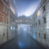 The Bridge of Sighs in the early morning fog, Venice