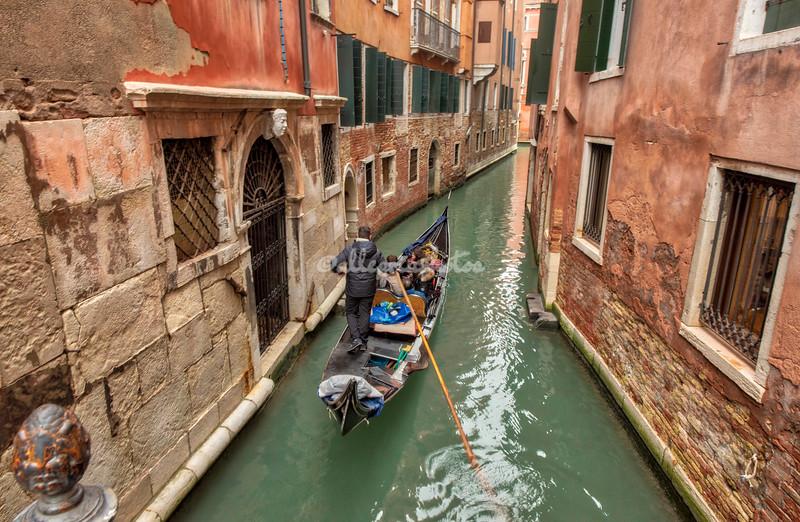 Gondola gliding through the canals, Venice