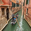 Gondola gliding through the canals, Venice