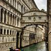 Riding a gondola under the Bridge of Sighs on a rainy morning
