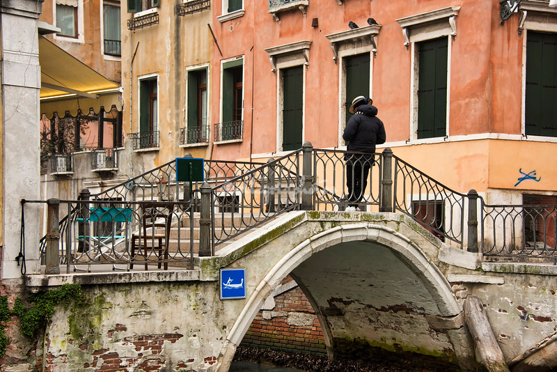 An idle gondolier waiting for a fare, Venice