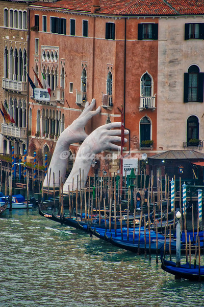 """SUPPORT"" by Italian sculptor Lorenzo Quinn"