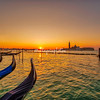 View along line of Gondolas and San Giorgio Maggiore at sunrise