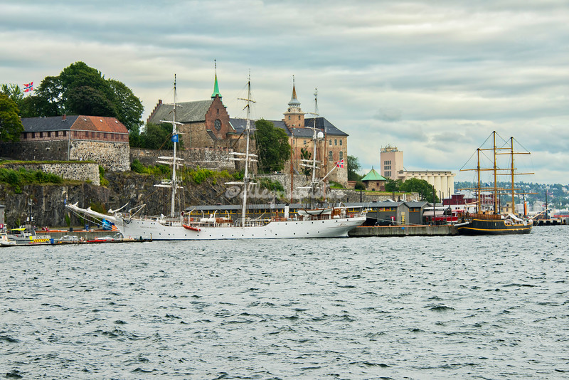 "View across Oslo harbor, Norway, with Akershus Fortress and the three masted ships, ""Christian Radich"" and ""Lady Mack"""