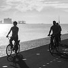 Silhouette of people, cycling along river, Santa Maria de Belem, Lisbon, Portugal