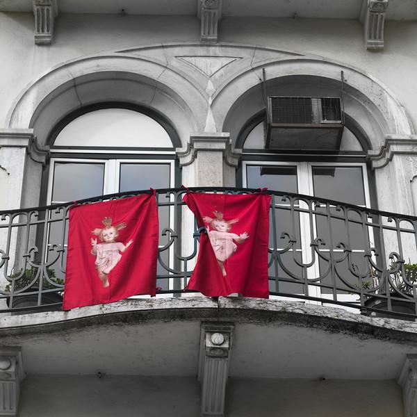 Flag of Nino Jesus on balcony of building, Lisbon, Portugal