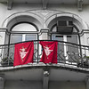 Flag of Nino Jesus on balcony of building, Lisbon, Portugal