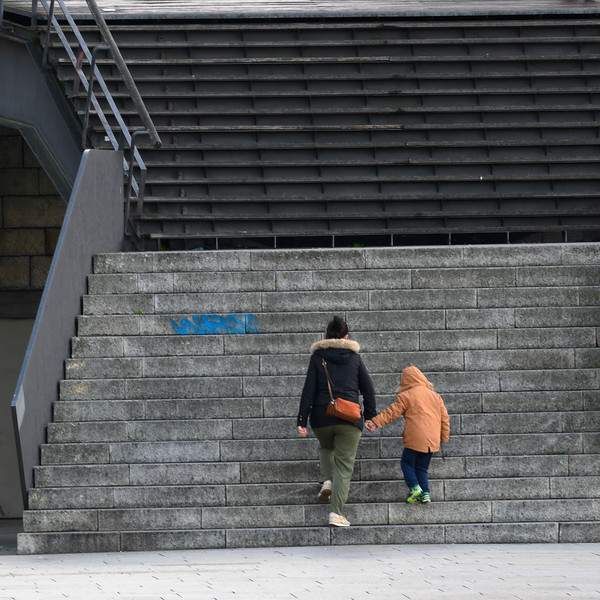 Woman with her child moving up steps, Sao Nicolau, Porto, Portugal