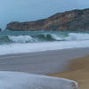 Scenic view of waves crashing on the beach, Nazare, Portugal