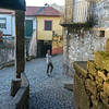 Woman standing on street, Old Jewish Quarter, Selzedas, Douro Valley, Portugal