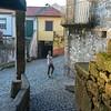 Woman standing on street, Old Jewish Quarter, Selzedas, Douro Valley, Portugal