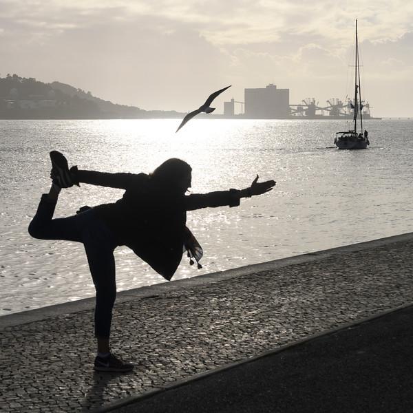Woman exercising on riverfront, Santa Maria de Belem, Lisbon, Portugal