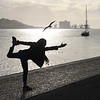 Woman exercising on riverfront, Santa Maria de Belem, Lisbon, Portugal