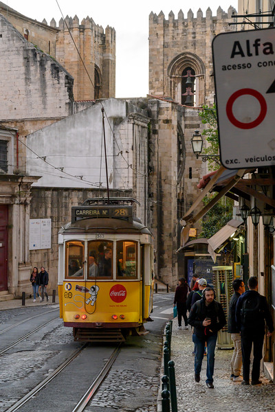 Cable car with Lisbon Cathedral in the background, Lisbon, Portugal