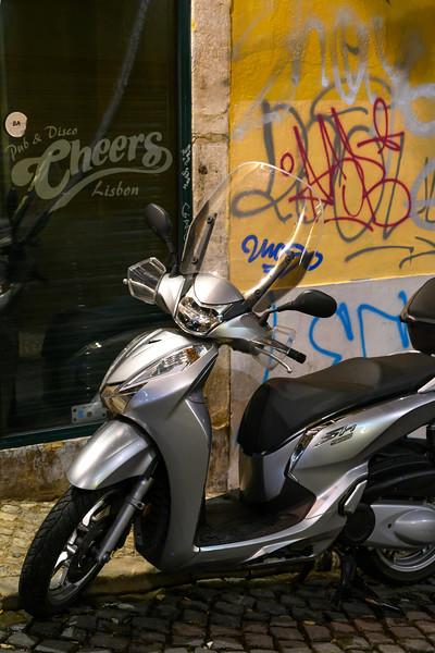 Motor scooter parked at roadside, Encarnacao, Lisbon, Portugal