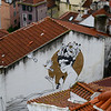 Drawing covering a wall on a house seen from Miradouro de Santa Luzia, Sao Miguel, Lisbon, Portugal