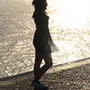 Silhouette of woman at riverfront, Alcantara, Lisbon, Setubal District, Portugal