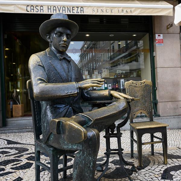 Statue of Fernando Pessoa the famous Portuguese poet in front restaurant, Sacramento, Lisbon, Portugal