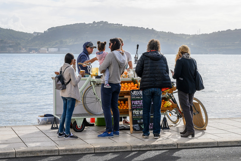 Tourists at juice stall, Santa Maria de Belem, Lisbon, Portugal