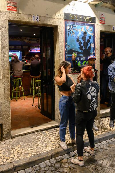 Two women outside a bar, Encarnacao, Lisbon, Portugal