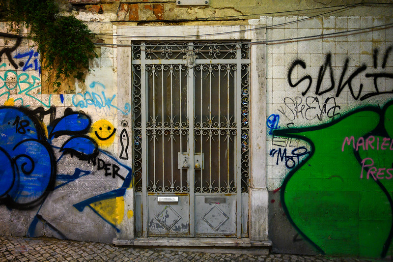 Graffiti on the wall of typical house in Encarnacao, Lisboa Region, Portugal