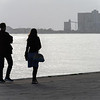 Silhouette of couple at riverfront, Targus River, Santa Maria de Belem, Lisbon, Portugal