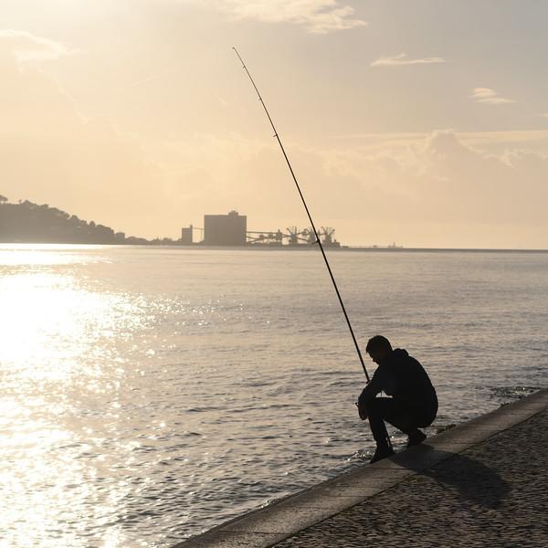 Man fishing in river, Alcantara, Lisbon, Setubal District, Portugal