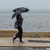 Two women walking at waterfront, Tagus River, Sao Nicolau, Lisbon, Portugal