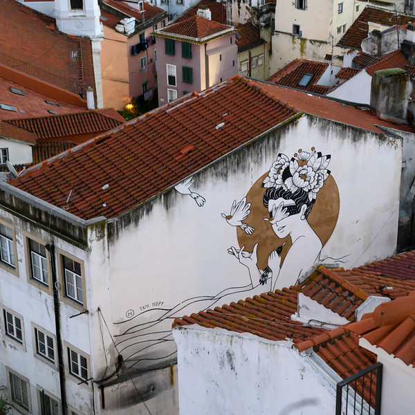Sketch on the wall of house seen from Miradouro de Santa Luzia, Sao Miguel, Lisbon, Portugal