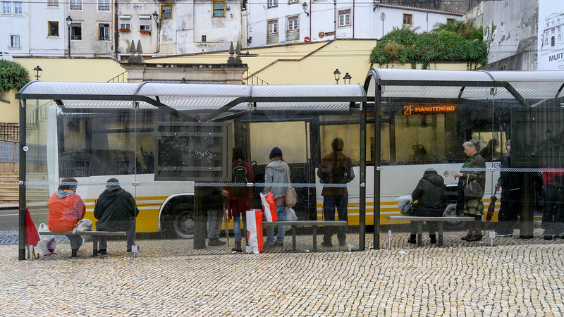 Passengers waiting at bus stop, Coimbra, Coimbra District, Portugal