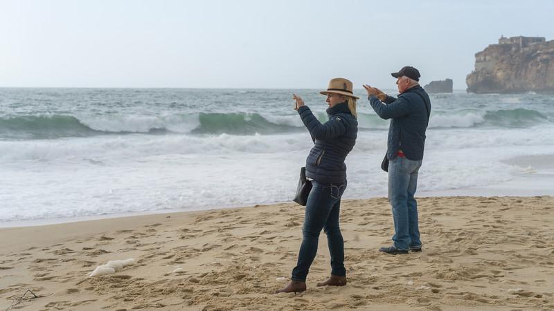 Tourists on the beach, Nazare Beach, Nazare, Leiria District, Portugal
