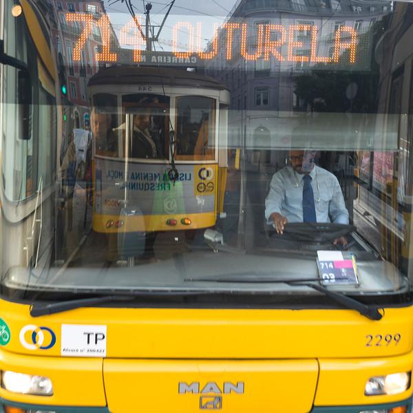 Reflection of tram in bus windshield, Lisbon, Portugal