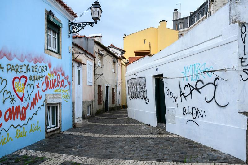 Painted houses on narrow street, Bairro Alto, Lisbon, Portugal