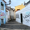 Painted houses on narrow street, Bairro Alto, Lisbon, Portugal