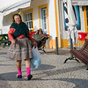 Native woman walking on street, Nazare, Leiria District, Portugal