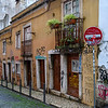 Markings on houses on a street, Bairro Alto, Lisbon, Portugal
