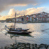 Boats in river with buildings in the background, Douro River, Sao Nicolau, Porto, Northern Portugal, Portugal
