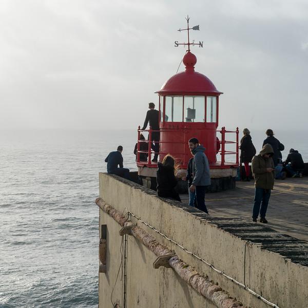 Tourists at Nazare Lighthouse, Nazare, Leiria District, Portugal