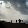 Silhouette of people on the beach, Nazare, Portugal