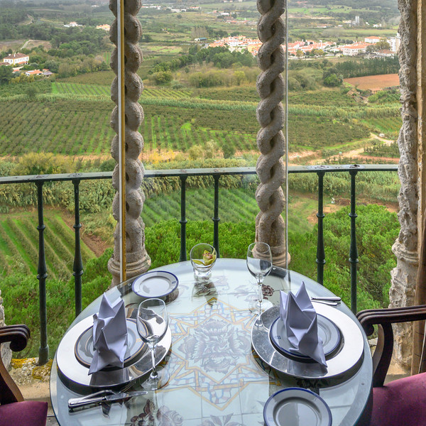 Table setting on the balcony of a house, Obidos, Leiria District, Portugal