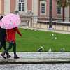 Two People walking in park, Lisbon, Portugal