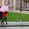 Two People walking in park, Lisbon, Portugal