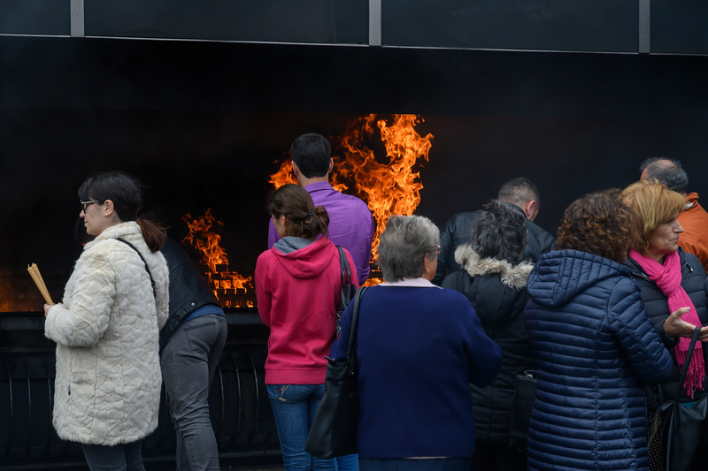 People throwing candles in fire at the Fatima Shrine, Fatima, Ourem Municipality, Santarem District, Portugal